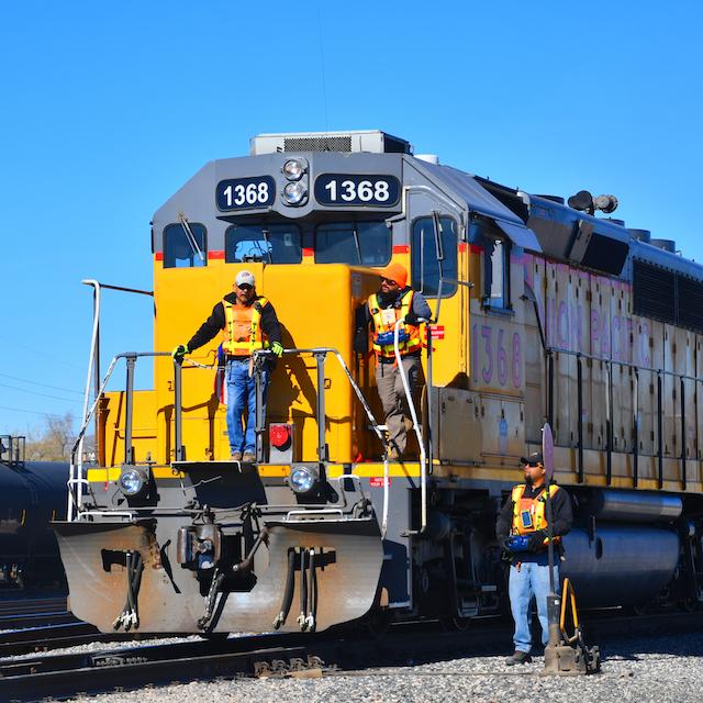 Men around locomotive